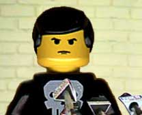 Lego minifig with bad hair behind Photoshopped bank of microphones
