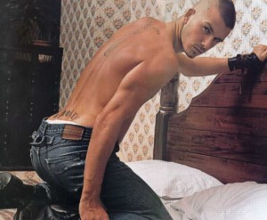 Sexy-ass picture of David Beckham on a bed