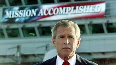 Bush with 'mission accomplished' banner in background