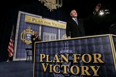 Bush at a podium, with posters