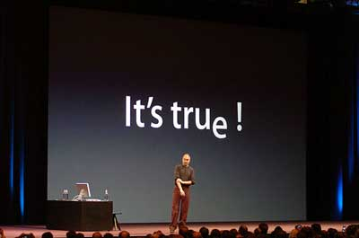 Steve Jobs in front of slide reading 'It's true!'-with a dropped 'e'