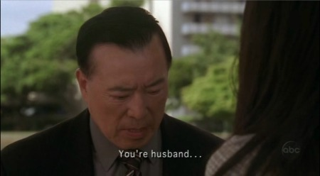 man with on-screen subtitle reading: You're husband...